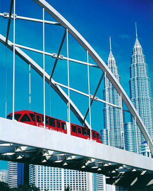 Train crossing in front of Petronas Towers, KL, Malaysia