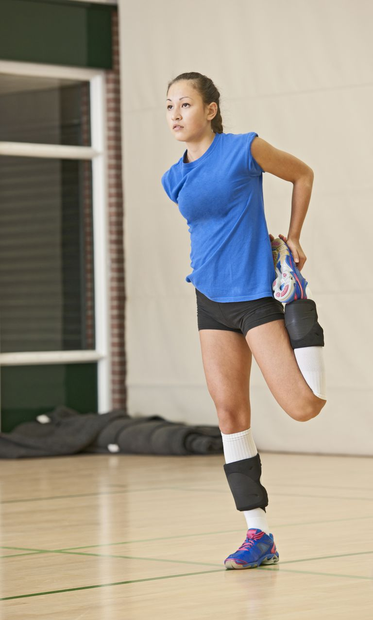 Female volleyball player stretching