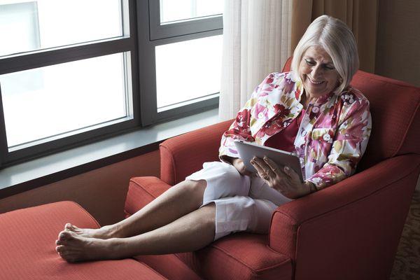 Older woman looking at ipad