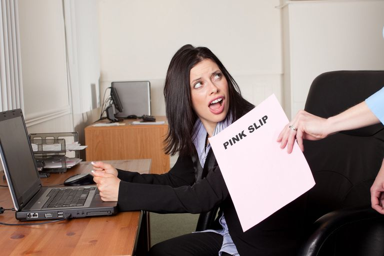 A picture of a woman getting a pink slip