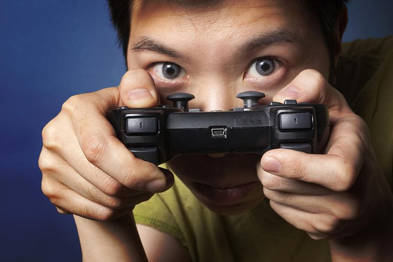 Chinese man with [Playstation] controller
