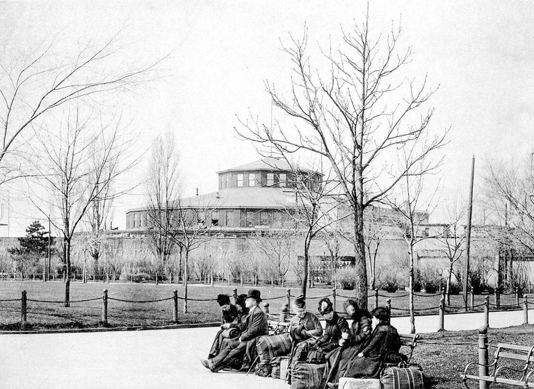 Immigrants sit on benches at the Castle Garden immigration station in New York City.