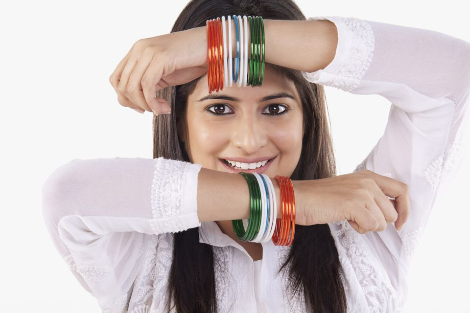 Woman showing off colorful bangle bracelets
