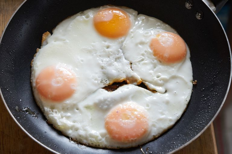 4 eggs frying in a pan