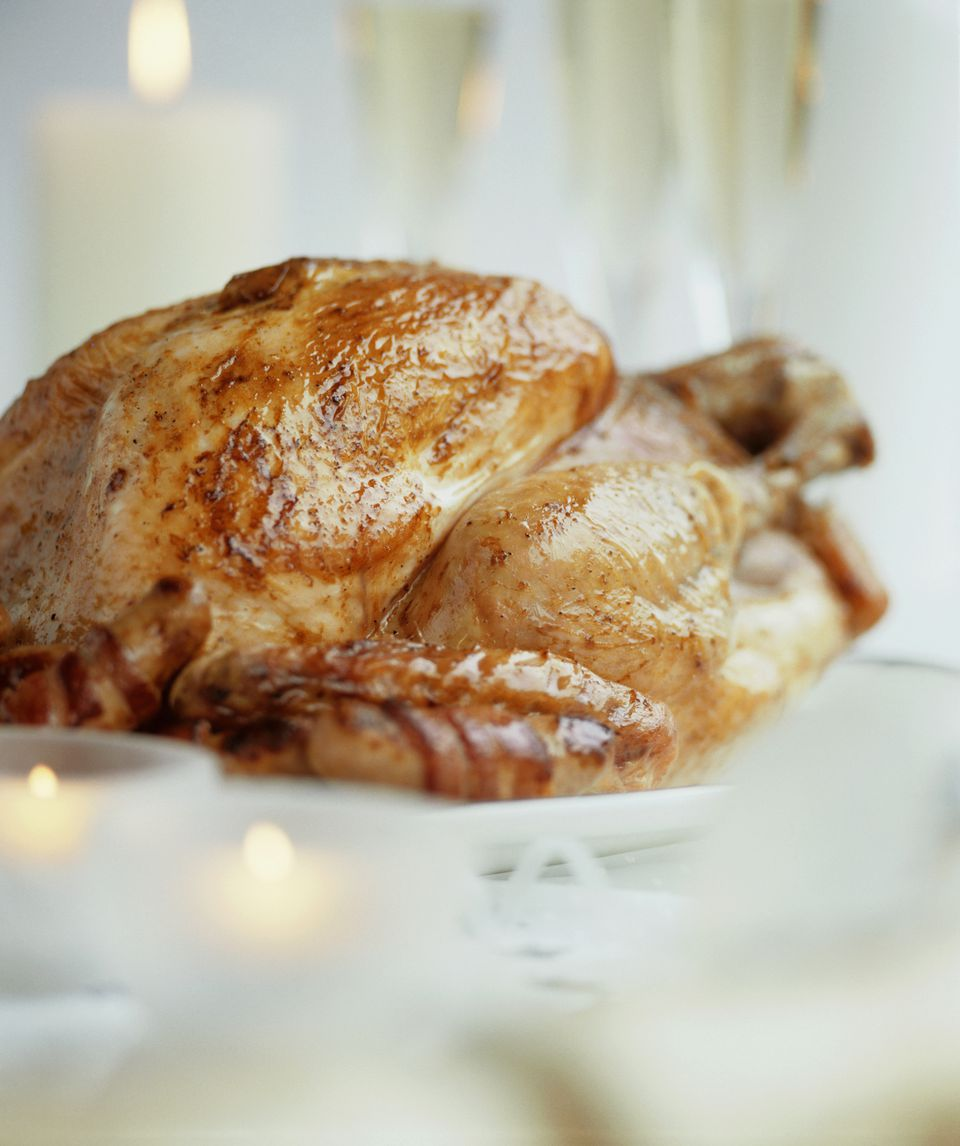 Roast turkey on festive table, close up (differential focus)