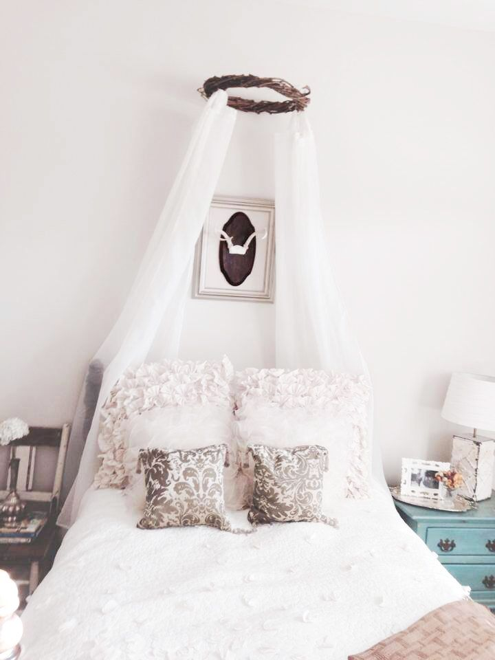 Girl's room with beautiful DIY wreath canopy.