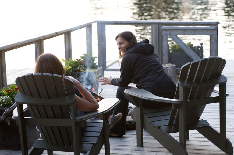 Family relaxing on deck, Lake of the Woods, Ontario, Canada, being an awesome auntie to a young girl