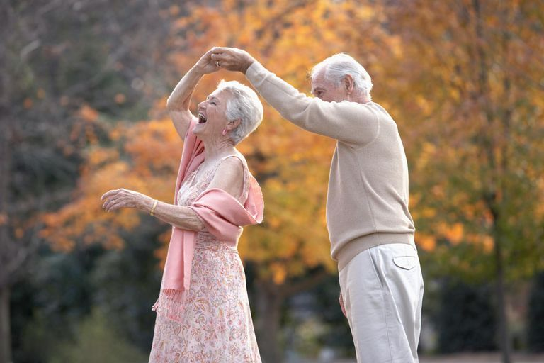 Senior couple dancing outdoors