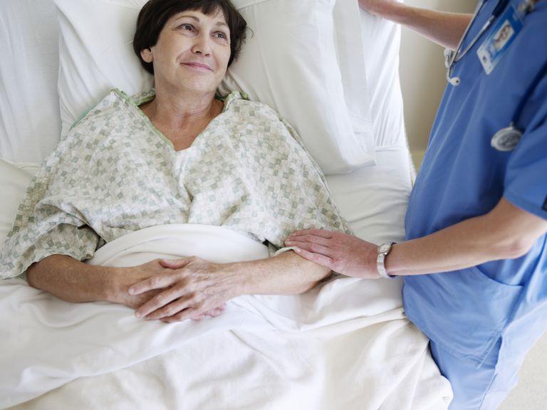 Nurse comforting senior female patient