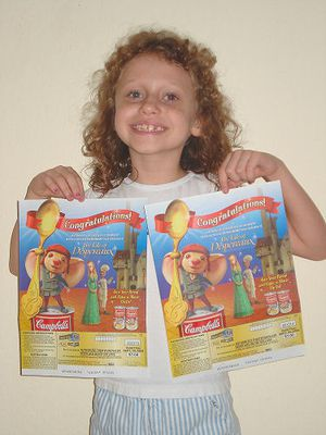 Photo of Grace M. with her prize, a pair of movie tickets from Campbell's Soup.