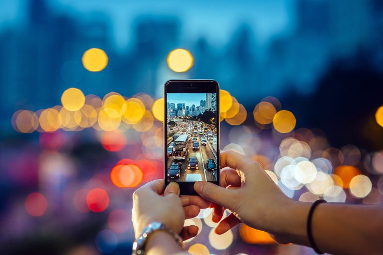The view through a smartphone camera symbolizes the definition of ideology.