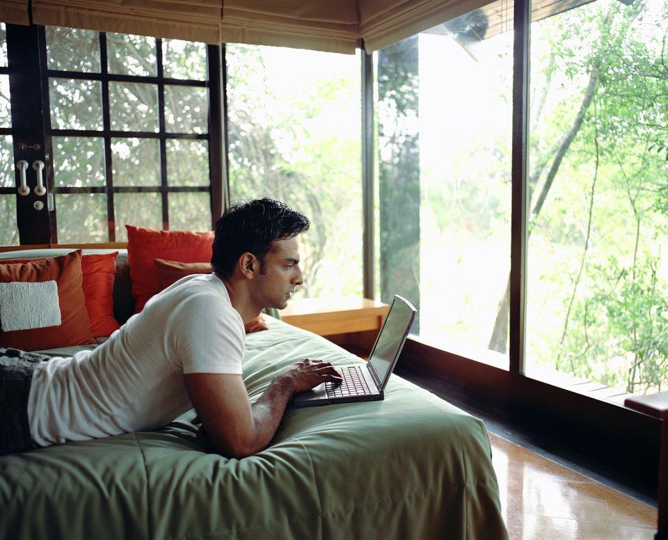 Man making travel plans on laptop