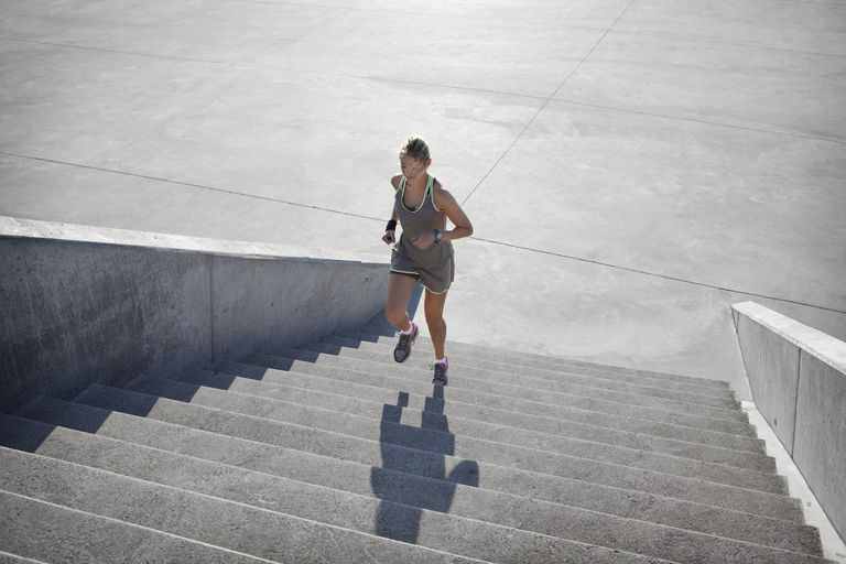 Woman running up stairs