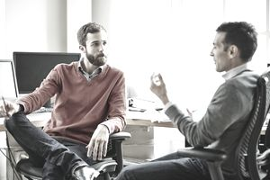 Two men discussing at work