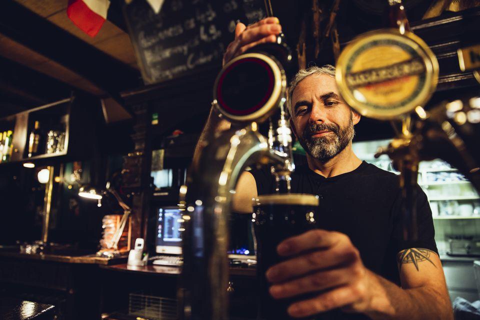 Man tapping beer in an Irish pub