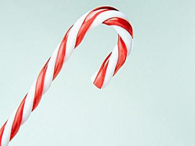 Picture of a candy cane against a light blue background