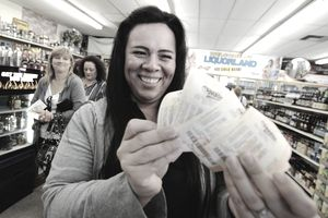 Image of a woman buying tickets for her lottery pool.