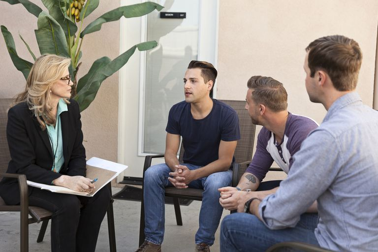 Mental Health Counselor leading therapy group