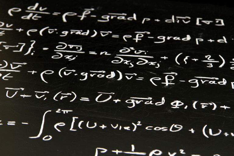 Photo of equations on a blackboard