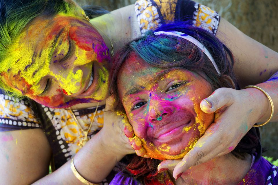 Mother and daughter celebrating Holi.