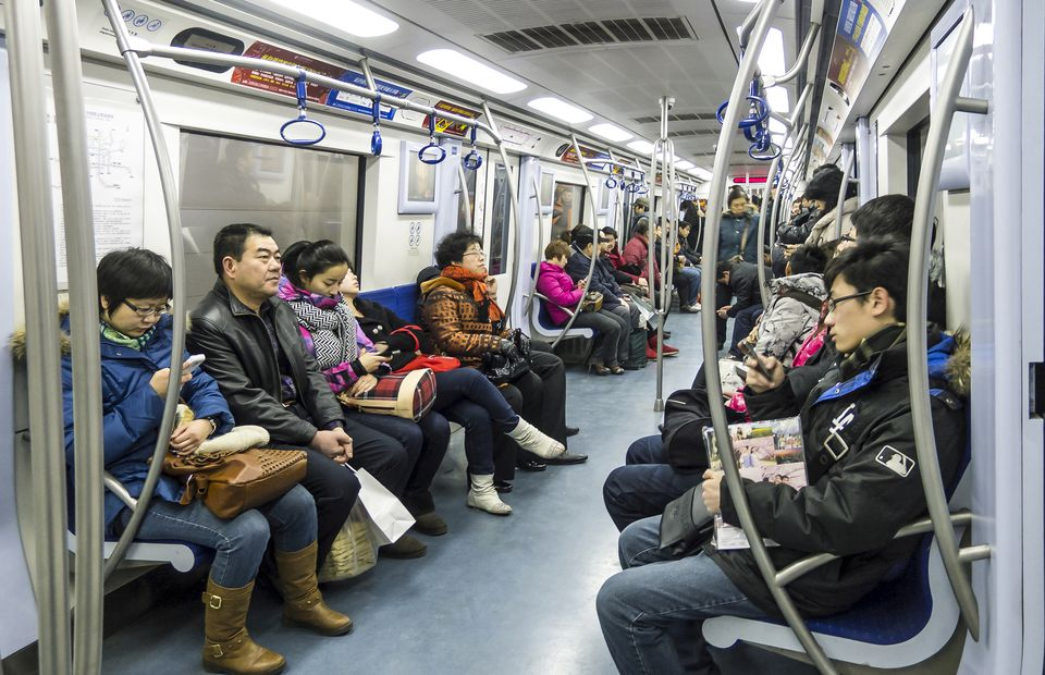 Riders in a subway. Beijing. China.
