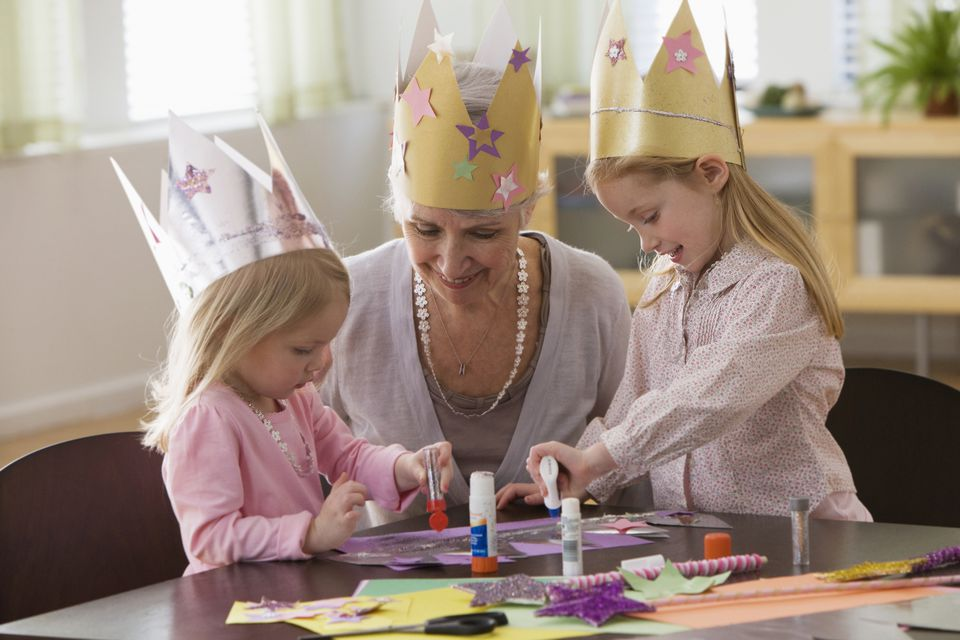 Grandmother and grandchildren working on arts and crafts
