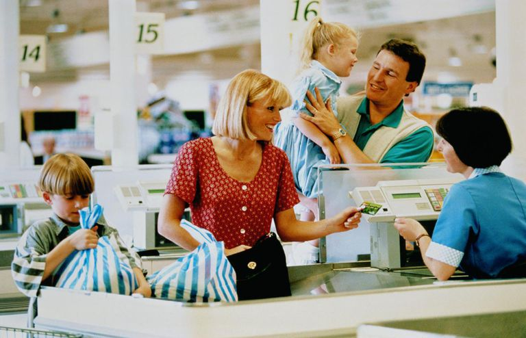 Family at checkout in supermarket