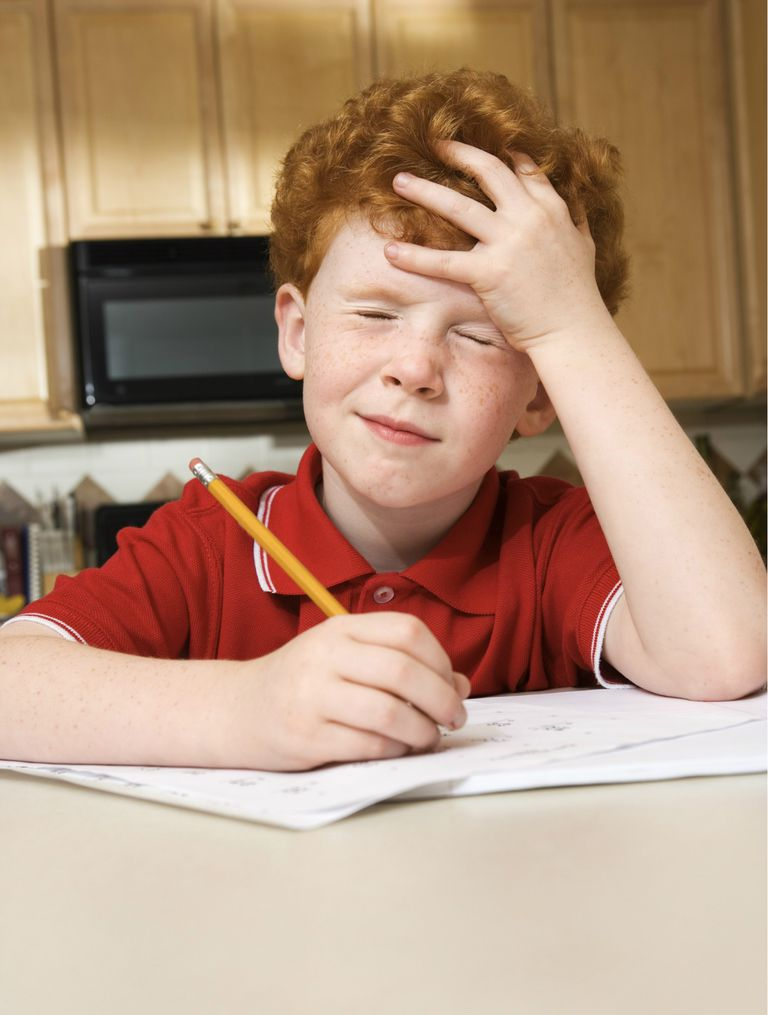 Frustrated boy doing homework
