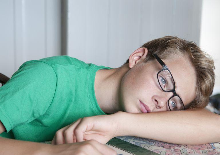 Young teen boy loooking very bored