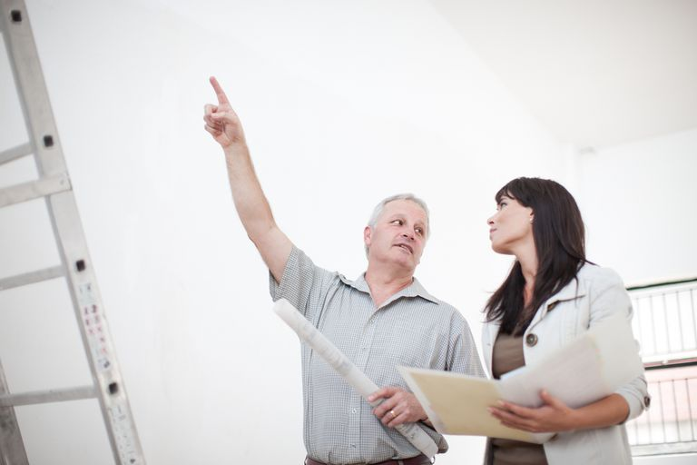 man giving home appraisal explaining to woman
