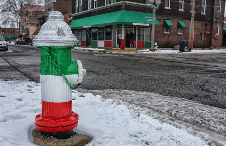 Fire hydrant painted with Italian flag colors
