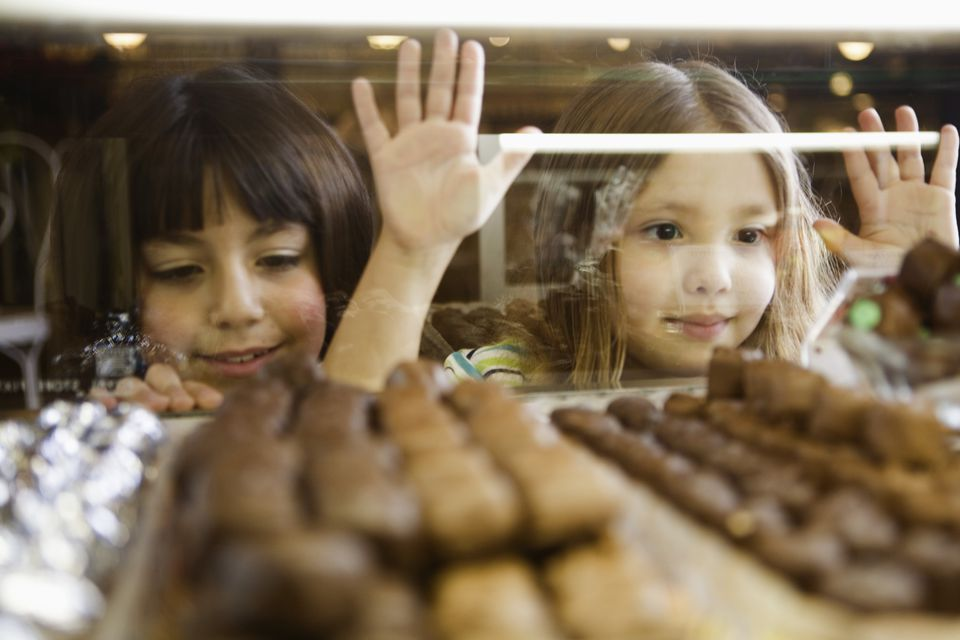 Girls pining for candy in display case