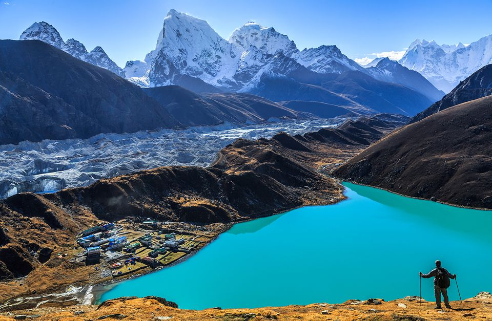 Male trakker standing on Gokyo Ri.