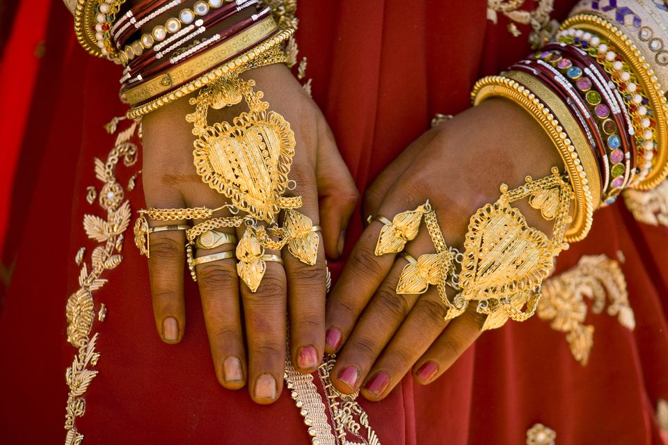 India, Jaisalmer, woman wearing gold jewellery