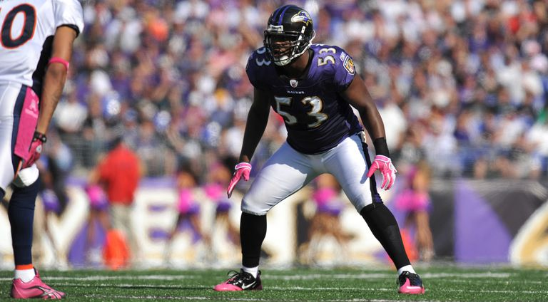 Ray Lewis #52 of the Baltimore Ravens defends against the Denver Broncos