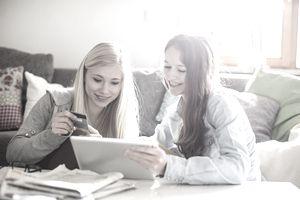 Teenage girls using tablet for online shopping