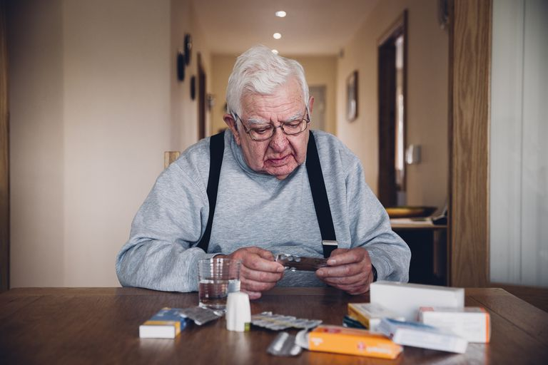 Senior man taking medication