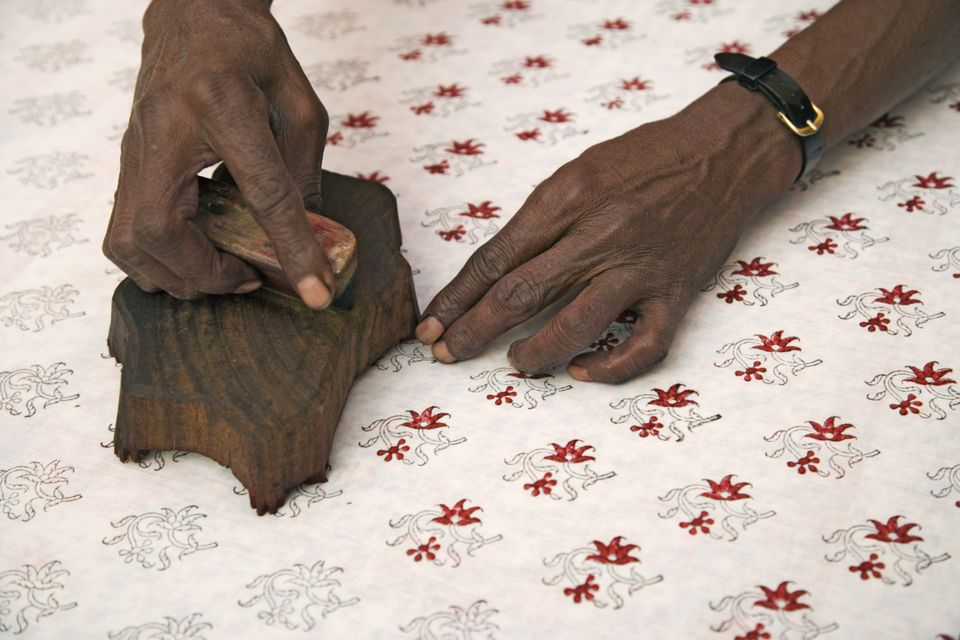Woman block printing fabric