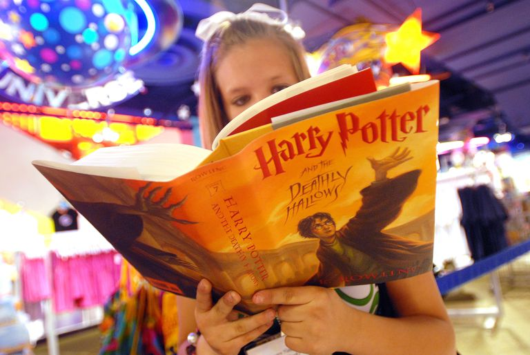 Girl reading Harry Potter and the Deathly Hallows, the final book in the series
