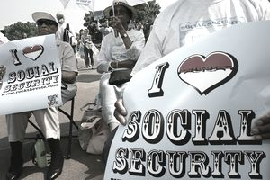 """People holding """"I love social security"""" signs"""