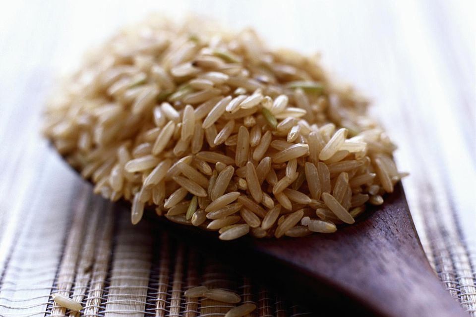 Brown rice on wooden spoon