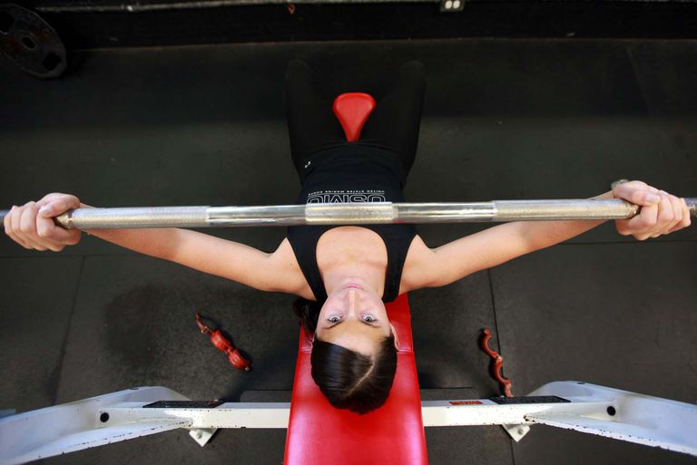 Woman doing a bench press