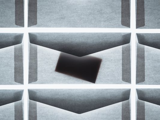 Envelopes with back lighting, showing contents