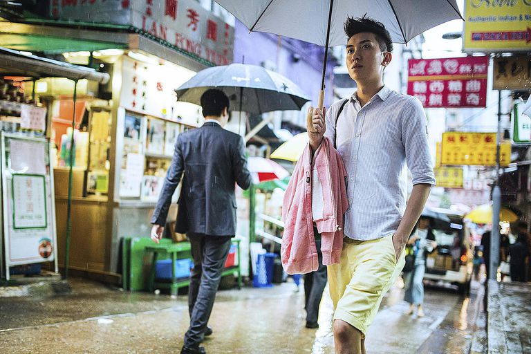 Hong Kong Walk in the Rain A young Chinese...