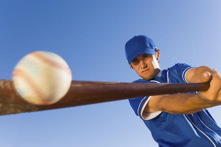 Batter Hitting Baseball