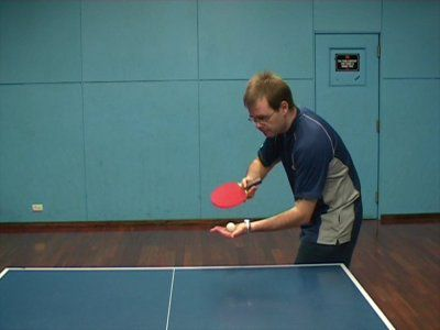 person playing table tennis