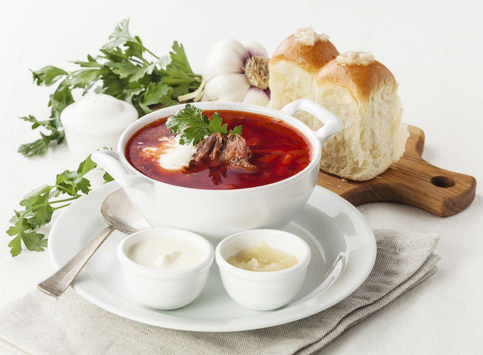 Red borsch with traditional Ukrainian bread pampushki