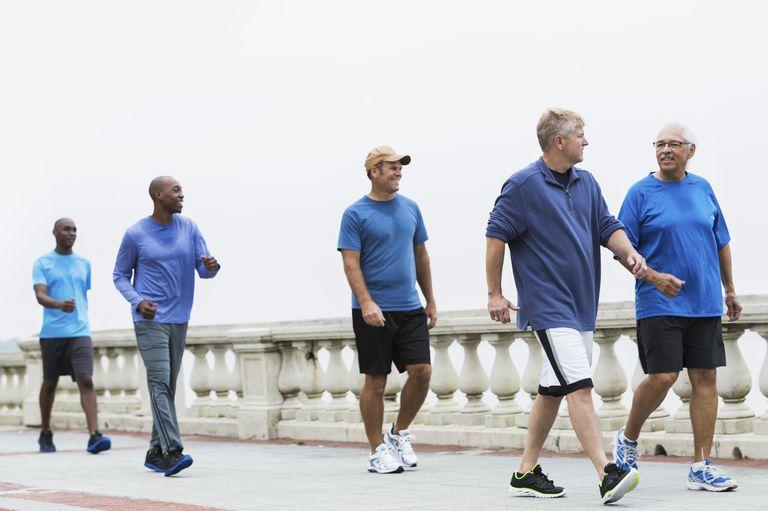 Group of Men Walking in Blue Shirts