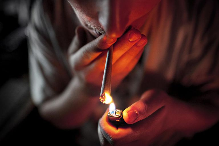 Man Lighting a Joint