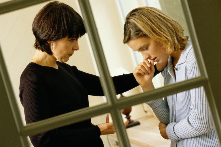 TWO WOMEN CONVERSING